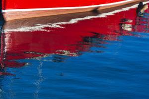 Ireland, County Fingal, Howth, Howth Harbor, boat reflections by Walter Bibikow