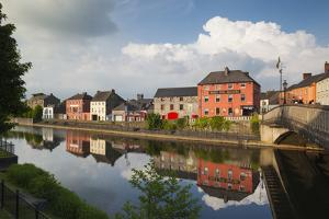 Ireland, County Kilkenny, Kilkenny City, pubs along River Nore by Walter Bibikow