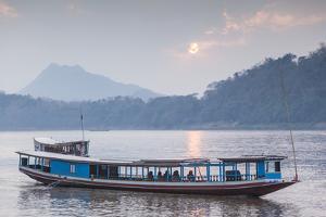 Laos, Luang Prabang. Riverboats on the Mekong River. by Walter Bibikow