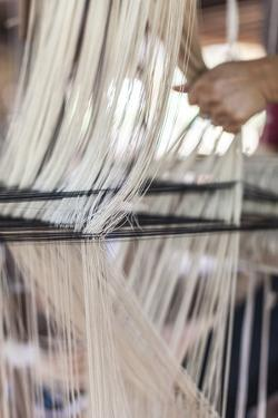 Laos, Vientiane. Traditional Lao textile loom. by Walter Bibikow