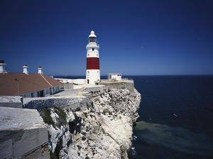 Lighthouse, Europa Point, Gibraltar, Spain by Walter Bibikow
