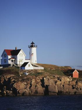 Lighthouse, York, Maine, USA by Walter Bibikow