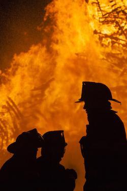Massachusetts, Cape Ann, Fourth of July Bonfire, Silhouette of Firemen by Walter Bibikow