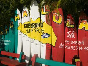 Mexico, Pacific Coast, Guerrero, Ixtapa, Catcha La Ola Surf Shop Sign by Walter Bibikow