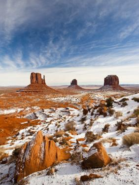 Monument Valley in the Snow, Monument Valley Navajo Tribal Park, Arizona, USA by Walter Bibikow