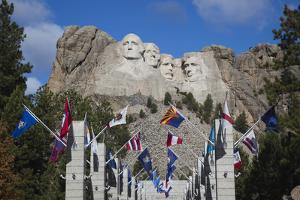 Mount Rushmore National Memorial, Avenue of Flags, South Dakota, USA by Walter Bibikow