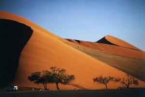 Namibia, Sossusvlei, Dune Sunset and Land Rover by Walter Bibikow