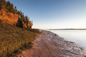 New Brunswick, Hopewell Rocks. Flowerpot Rocks formed by the great tides of the Bay of Fundy. by Walter Bibikow