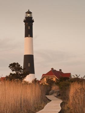 New York, Long Island, Fire Island, Robert Moses State Park, Fire Island Lighthouse, USA by Walter Bibikow