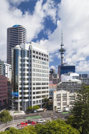 New Zealand, North Island, Auckland. CBD skyline and Sky Tower by Walter Bibikow