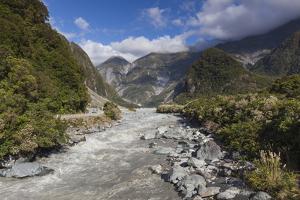 New Zealand, South Island, Fox Glacier Village, Fox Glacier hikers along Fox River by Walter Bibikow