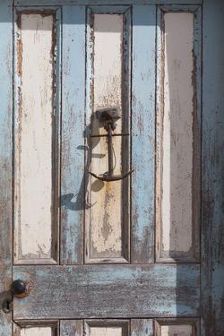 New Zealand, South Island, Otago, Moeraki, door detail with anchor by Walter Bibikow