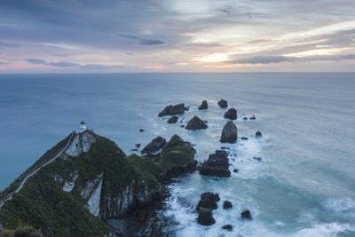 New Zealand, South Island, The Catlins, Nugget Point Lighthouse, dawn by Walter Bibikow