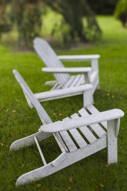 North Carolina, Outer Banks Seashore, Corolla, Adirondack Lawn Chairs by Walter Bibikow