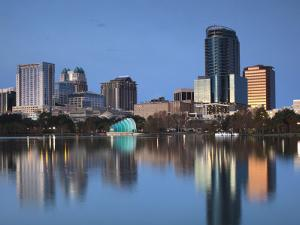 Orlando Skyline Across Lake Eola, Florida, USA by Walter Bibikow