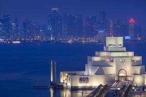 Qatar, Doha, Cityscape at Dusk by Walter Bibikow
