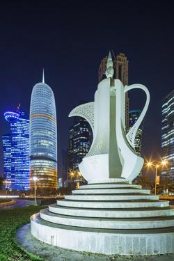 Qatar, Doha, Doha Bay, West Bay Skyscrapers, Dusk, with Large Coffeepot Sculpture by Walter Bibikow