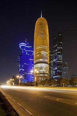 Qatar, Doha, Doha Bay, West Bay Skyscrapers Dusk, with World Trade Center , Gold by Walter Bibikow