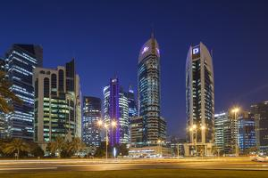 Qatar, Doha, Doha Bay, West Bay Skyscrapers, Dusk by Walter Bibikow