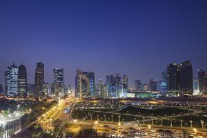 Qatar, Doha, Doha Bay, West Bay Skyscrapers, Elevated View, Dusk by Walter Bibikow