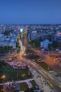 Romania, Bucharest, Piata Universitatii, Coltea Hospital at Dusk by Walter Bibikow