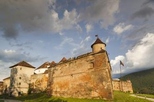 Romania, Transylvania, Brasov, Brasov Citadel, Sunset by Walter Bibikow