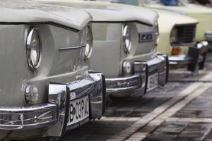 Romania, Transylvania, Brasov, Piata Sfatului Square, Antique Car Show by Walter Bibikow