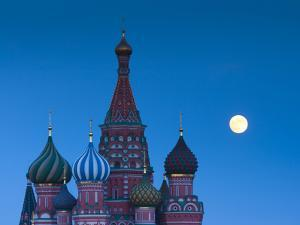 Russia, Moscow, Red Square, Kremlin, St. Basils Cathedral with Moonrise by Walter Bibikow