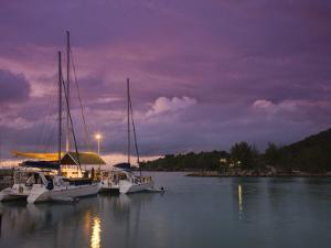 Seychelles, La Digue Island, La Passe, Harborview, Dusk by Walter Bibikow