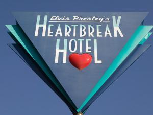 Sign for the Heartbreak Hotel, Memphis, Tennessee, USA by Walter Bibikow