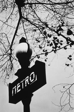 Sign for the Metro Subway, Paris, France by Walter Bibikow