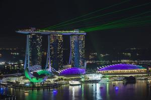 Singapore, Elevated View of the City with Evening Laser Show by Walter Bibikow