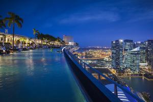 Singapore, Marina Bay Sands Hotel, Rooftop Swimming Pool, Dusk by Walter Bibikow