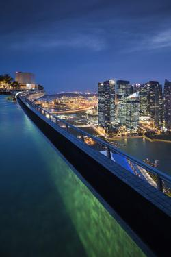 Singapore, Rooftop Swimming Pool at Dusk Overlooks the City by Walter Bibikow