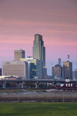 Skyline from the Missouri River at Dawn, Omaha, Nebraska, USA by Walter Bibikow