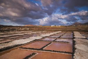 Spain, Canary Islands, Lanzarote, El Golfo, Salinas De Janubio, Salt Evaporation Pans, Sunset by Walter Bibikow
