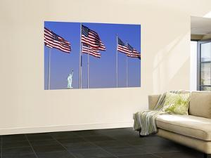 Statue of Liberty and Us Flags, New York City, USA by Walter Bibikow