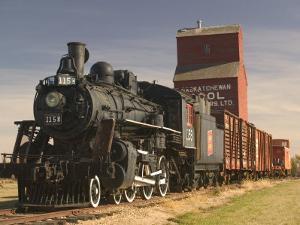 Steam Train and Grain Elevator in Western Development Museum, Saskatchewan, Canada by Walter Bibikow