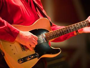 Swinging Guitar, Grand Ole Opry at Ryman Auditorium, Nashville, Tennessee, USA by Walter Bibikow