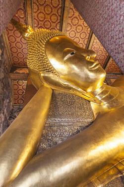 Thailand, Bangkok. Ko Ratanakosin, Wat Pho, Reclining Buddha. by Walter Bibikow