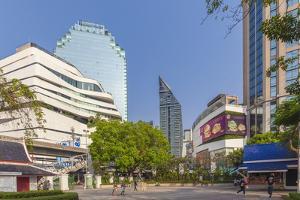 Thailand, Bangkok. Sukhumvit, city skyline from Benjasiri Park. by Walter Bibikow