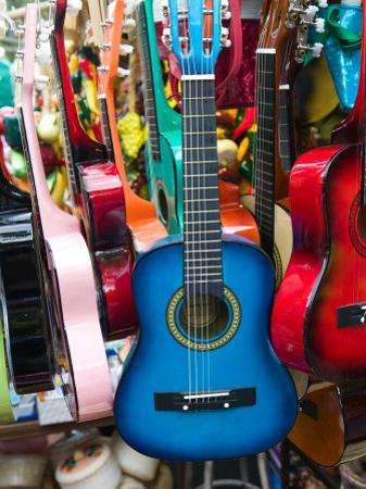 Toy Guitars, Olvera Street Market, El Pueblo de Los Angeles, Los Angeles, California, USA by Walter Bibikow