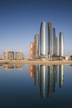 UAE, Abu Dhabi. Downtown waterfront skyscrapers. by Walter Bibikow