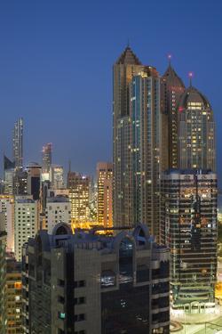 UAE, Abu Dhabi. Elevated skyline from Corniche Road East by Walter Bibikow