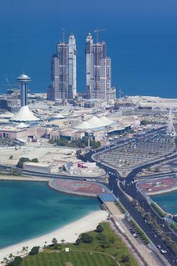 UAE, Abu Dhabi. Marina Village and Arabian Gulf, aerial view by Walter Bibikow