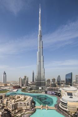 UAE, Downtown Dubai. Cityscape with Burj Khalifa. by Walter Bibikow