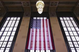 Us Flag Hanging in the Union Railroad Station, Omaha, Nebraska, USA by Walter Bibikow