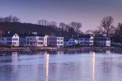 USA, Connecticut, Mystic, houses along Mystic River at dawn by Walter Bibikow