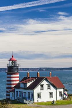 USA, Maine, Lubec. West Quoddy Head Light. by Walter Bibikow