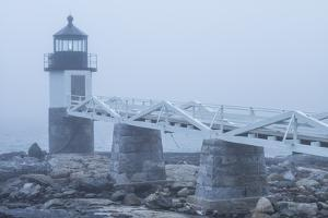 USA, Maine, Port Clyde. Marshall Point Lighthouse in the fog. by Walter Bibikow